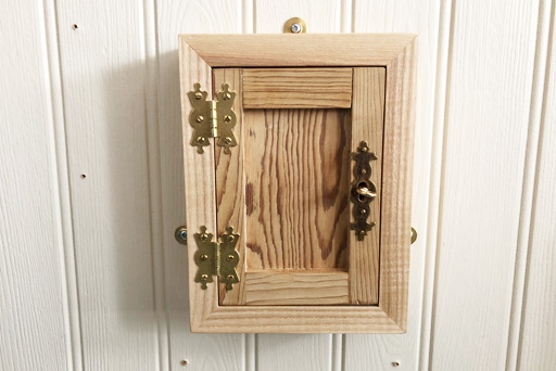 Box with door and lock and key